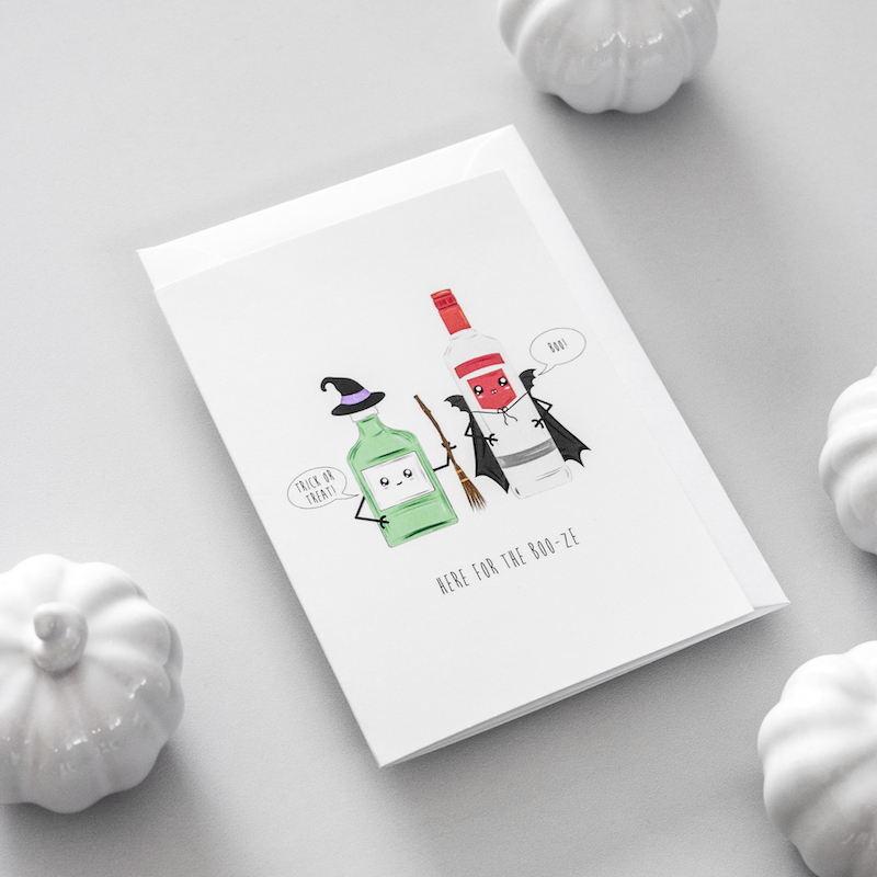 Hallowene card with an illustration of a bottle of gin and a bottle of vodka dressed up as a witch and a vampire.