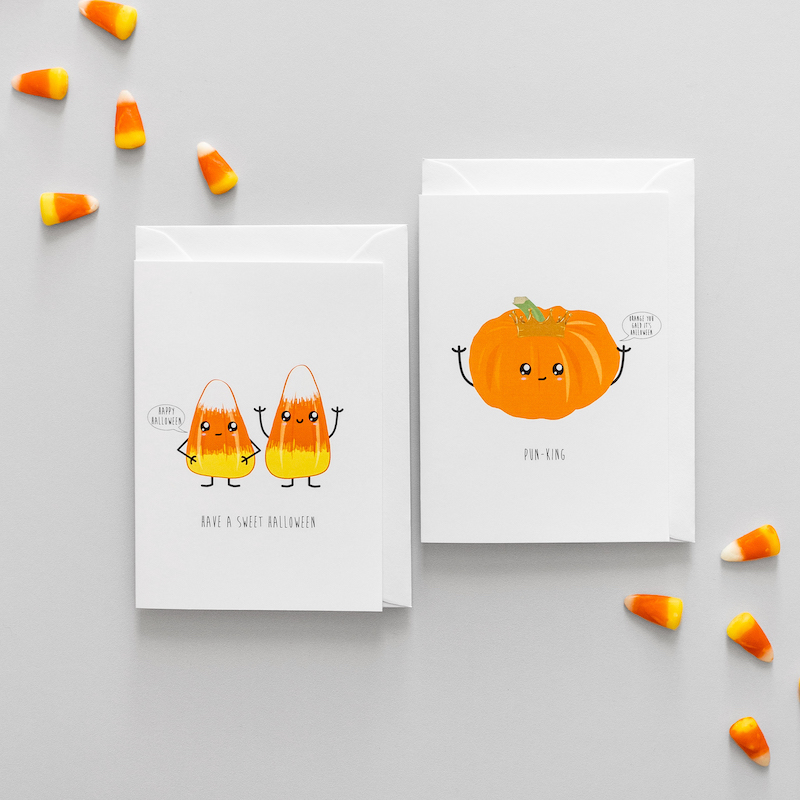 Two Halloween cards.  One is a pumpkin with a crown and the other is candy corn.