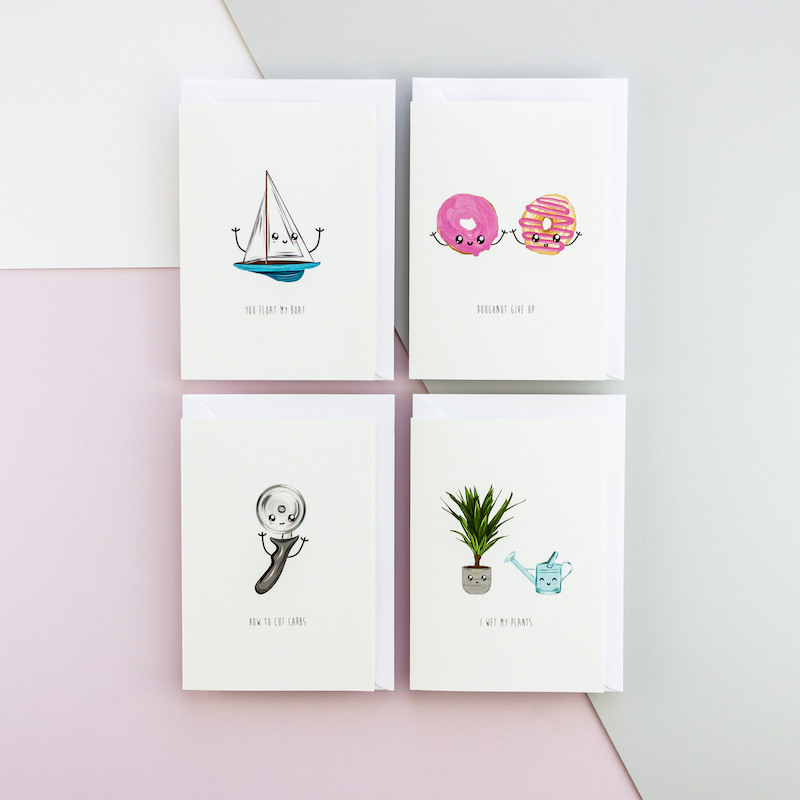 Four punny greeting cards arranged in a two by two grid. The illustrations are of a sailng boat, two dougnuts side by side, a pizza cutter and a watering can with a potted plant. Of course all these illustrations have a funny face.