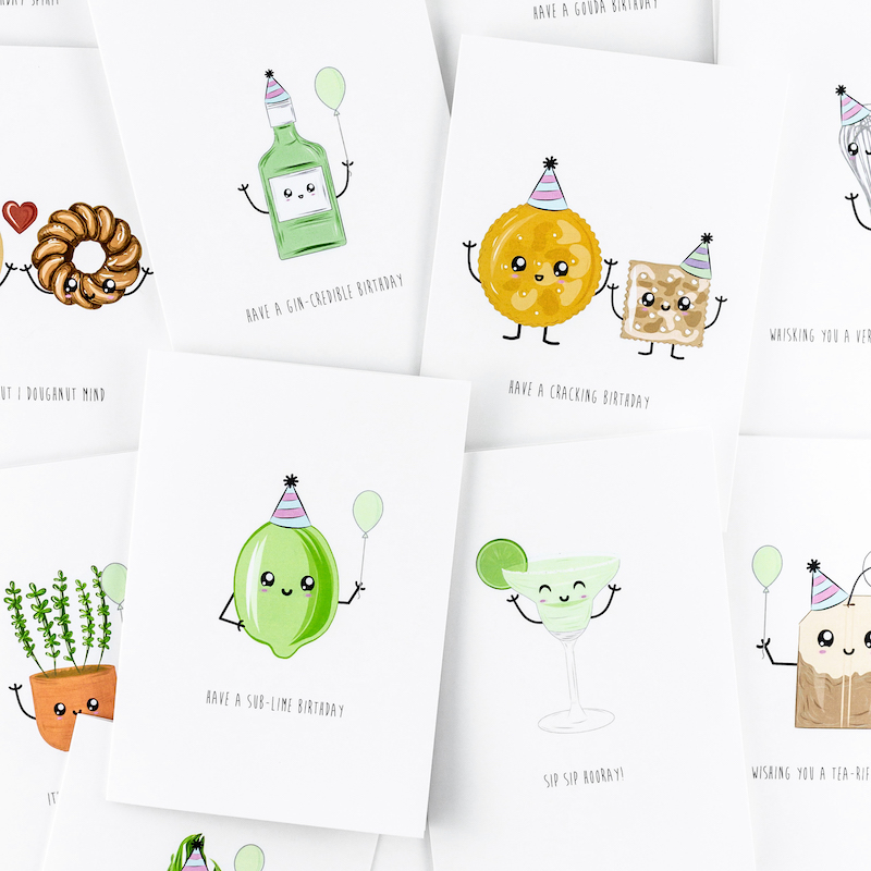 A selection of about ten different punny greeting cards. The illustrations include such objects as a bottle of gin, cheese crackers, a lime, a cocktail glass and a tea bag. Each illustration has bee give a cartoon style fave. Some have party hats and balloons.