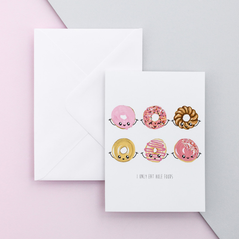 A jocular greeting card of six dougnuts in two rows of three. The doughnuts have various toppings - glazed, pink icing chocolate and have been drawn with funny faces and arms.