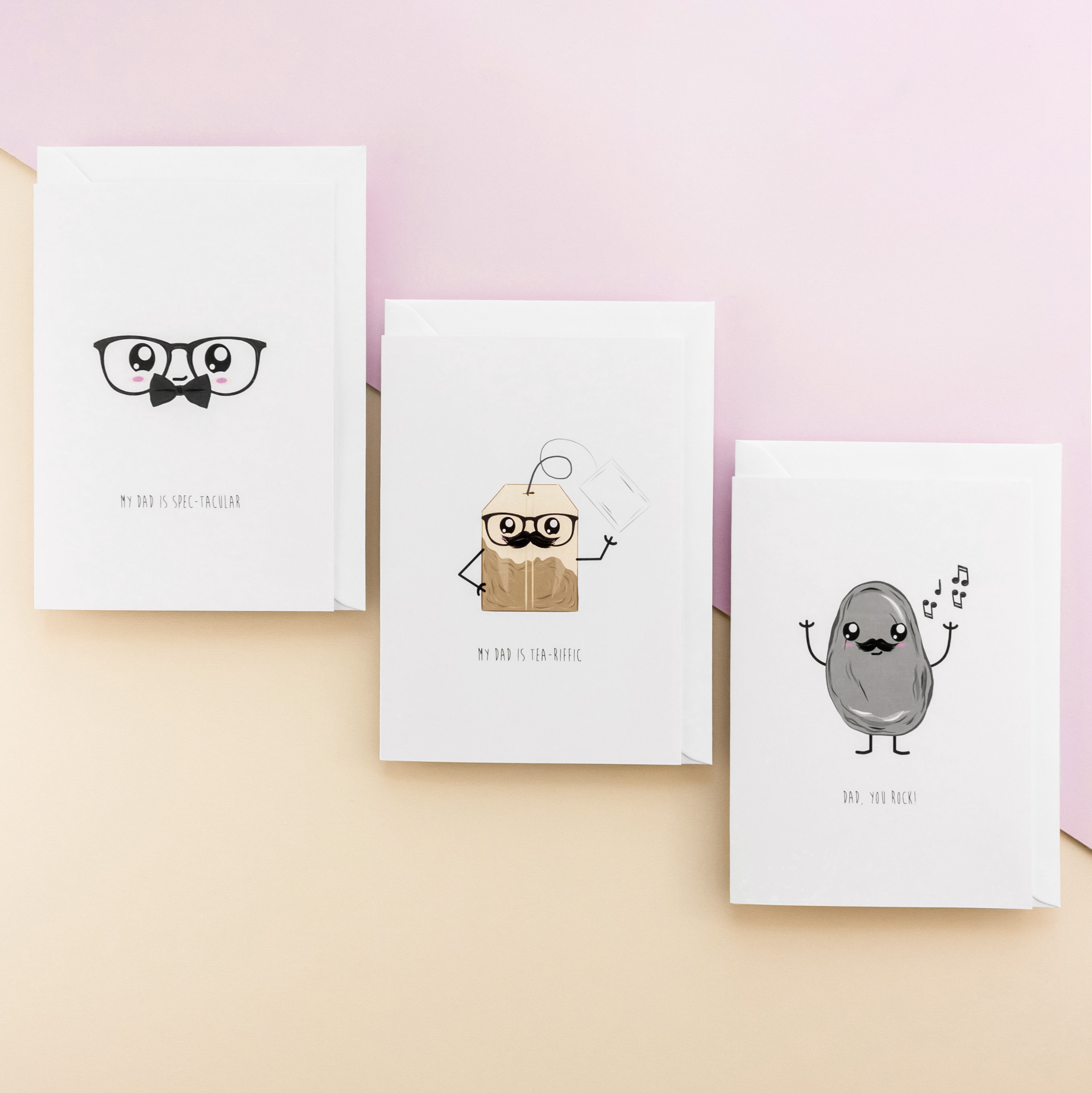Three waggish greeting cards - one with an illustration of a pair of glasses with a bow tie and big eyes, the second a tea bag with a pair of glasses and a moustache and the third is a rock with arms, legs and a funny face looking like it is have a dance.