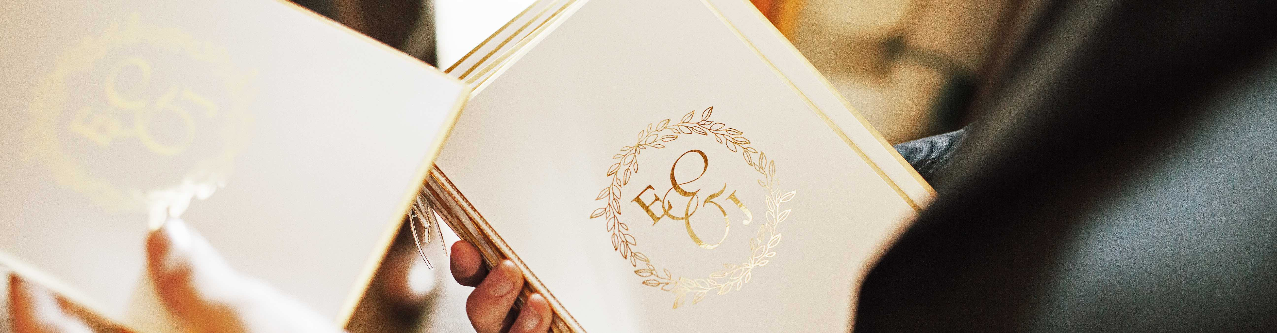 Order of Service with Metallic Gold Foil Logo from a Bespoke Wedding Stationery Package